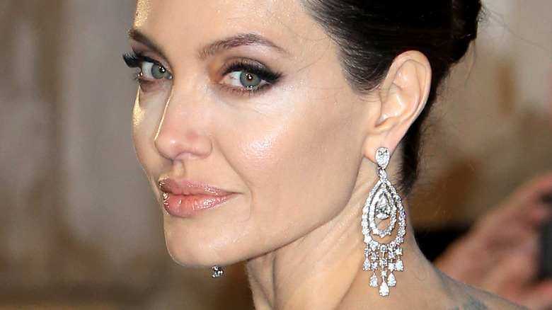 Angelina Jolie turning to the side at red carpet event