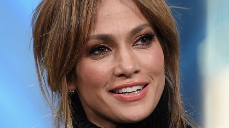 Jennifer Lopez smiling and looking to the side