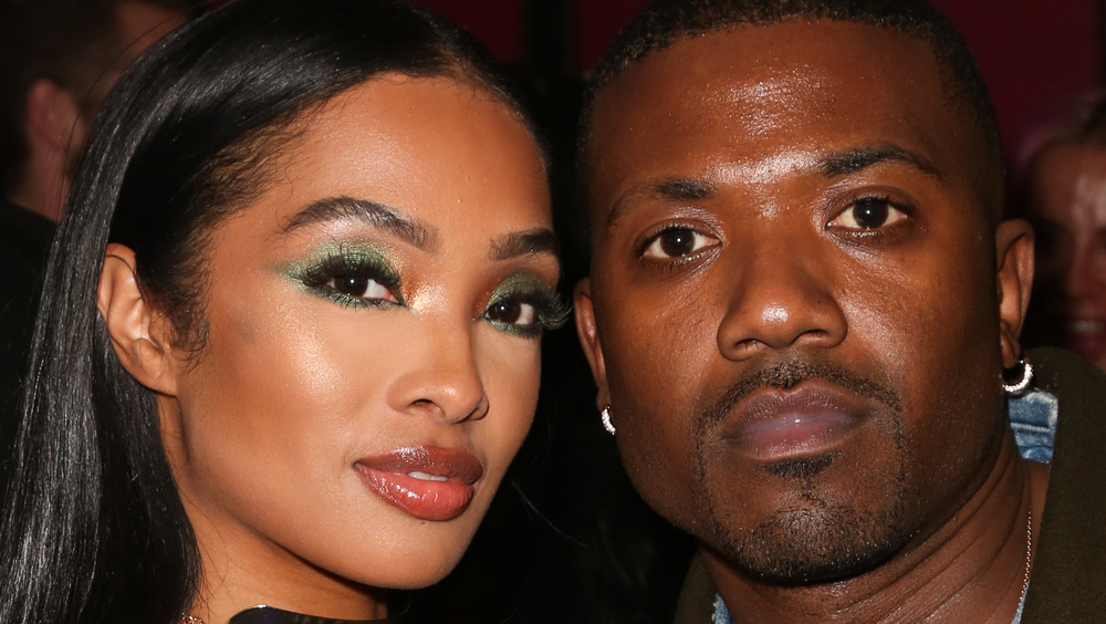 Princess Love and Ray J posing together at an event