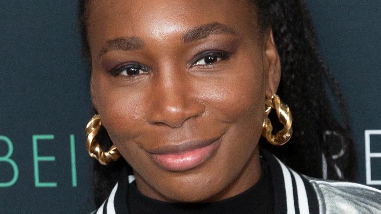 Venus Williams gold hoop earrings
