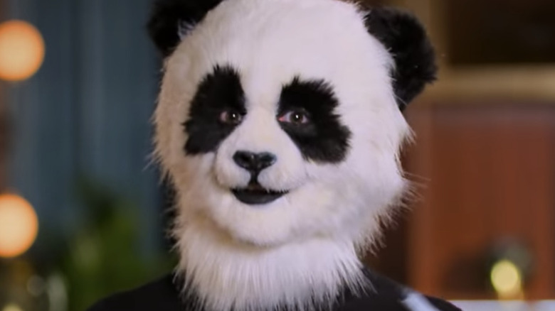 Close up of Kariselle in her panda head