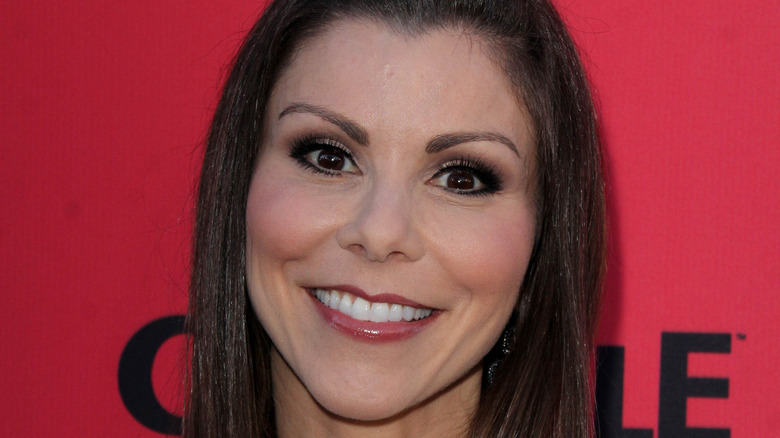 Heather Dubrow smiling on red carpet