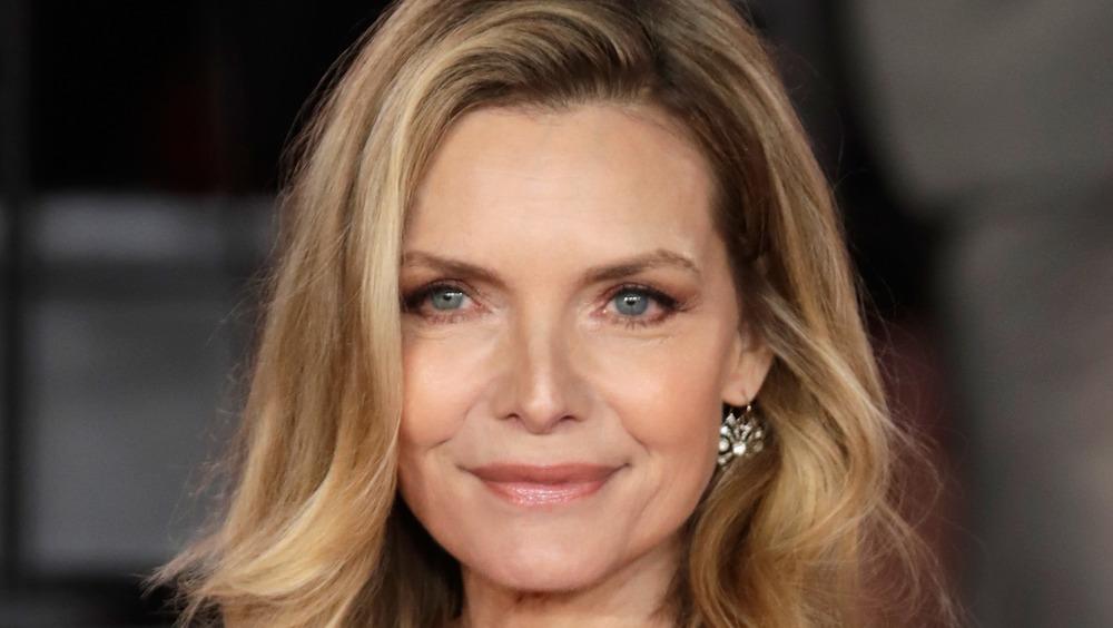 Michelle Pfeiffer posing on red carpet