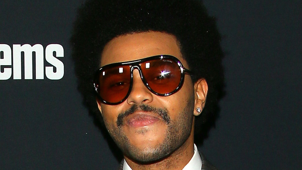 The Weeknd posing in sunglasses