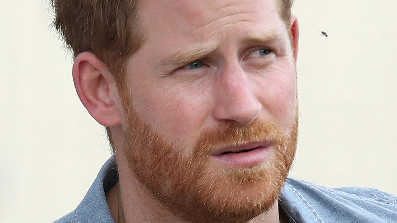 Prince Harry frowning