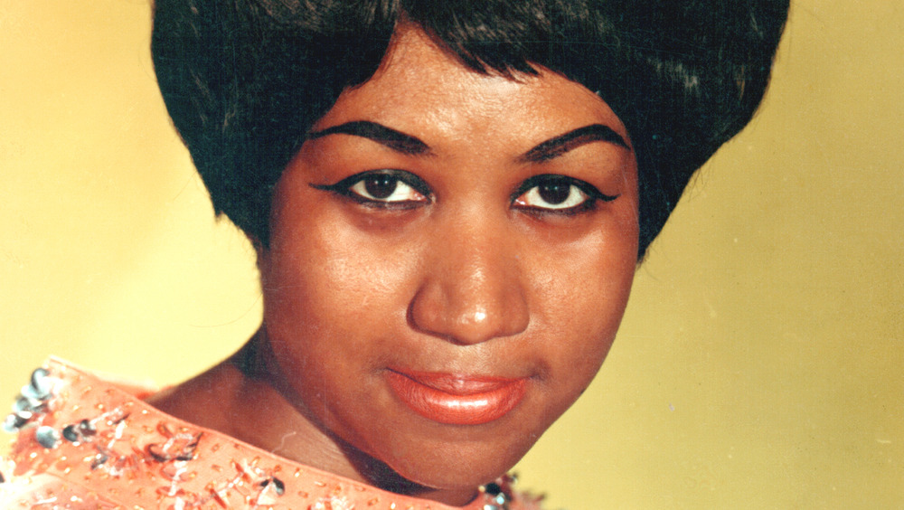 Aretha Franklin smiling for a promotional photo