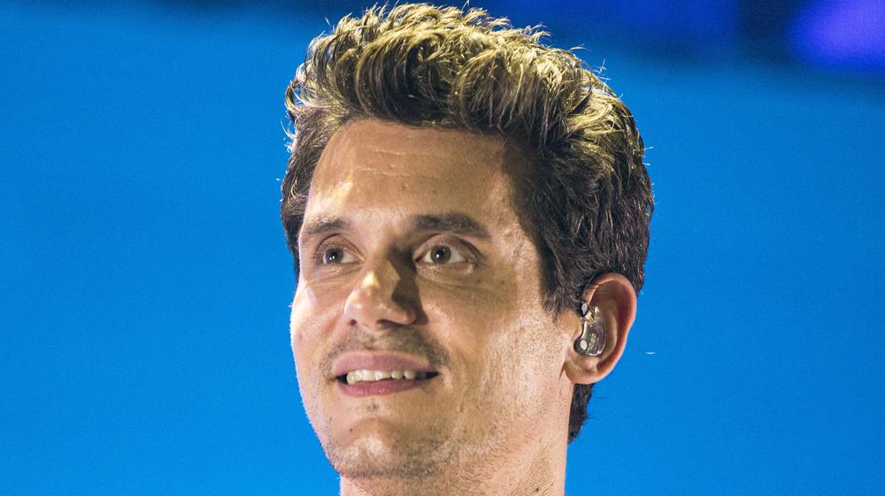 John Mayer looking up smiling