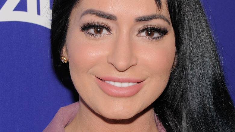 Angelina Pivarnick smiles on the red carpet