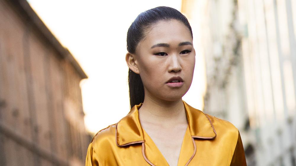 Jaime Xie poses yellow blouse