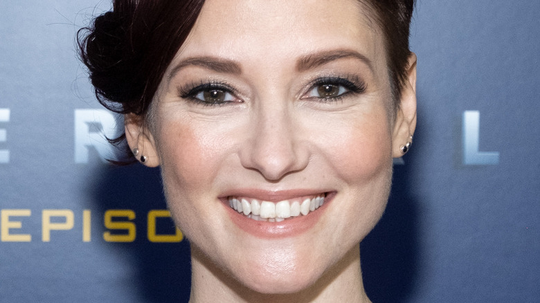Chyler Leigh smiles on the red carpet