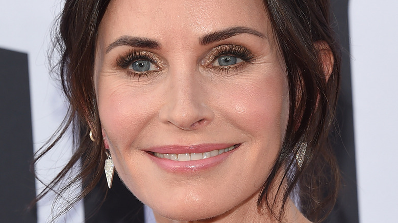 Courteney Cox with hair pulled up