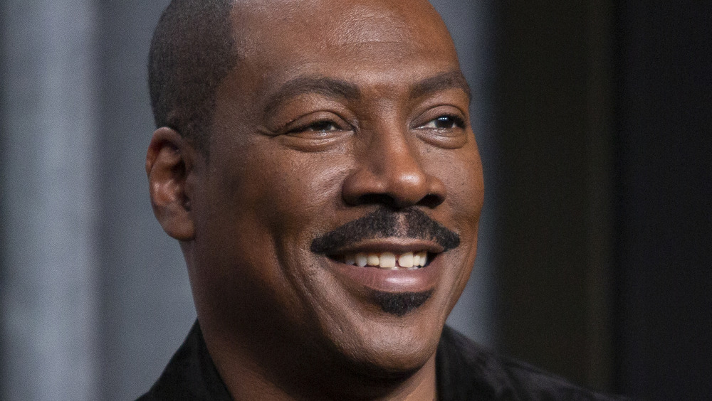 Eddie Murphy smiling at an event