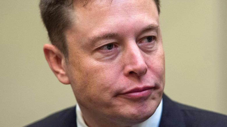 Elon Musk pursing lips
