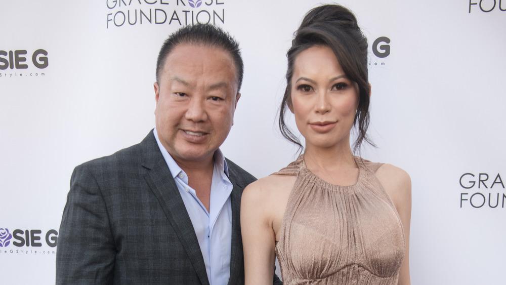 Dr. Gabriel Chiu and Christine Chiu smiling on the red carpet