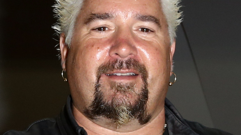 Guy Fieri smiling at the camera