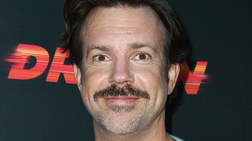 Jason Sudeikis smiling at an event