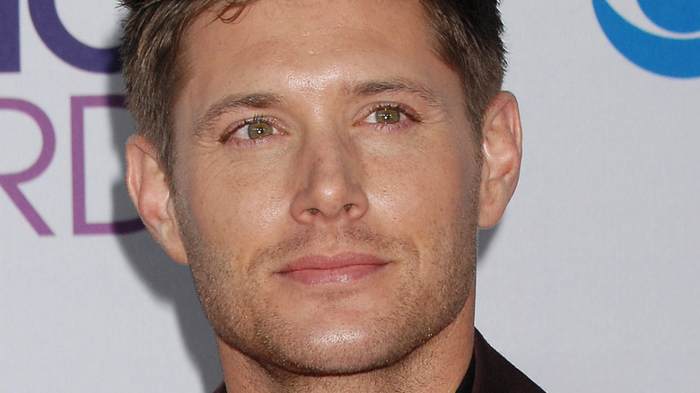 Jensen Ackles poses at an event