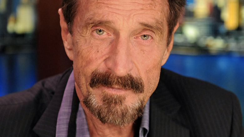 John McAfee looking at camera during interview in 2012