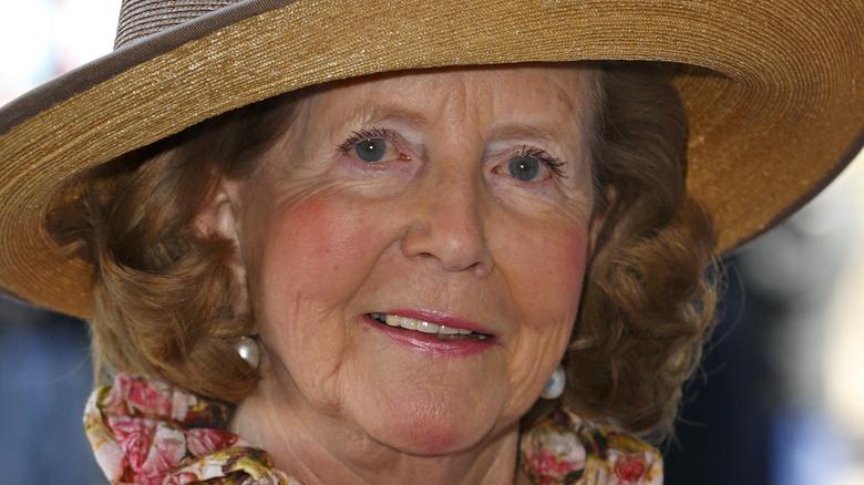 Lady Anne Glenconner posing in hat