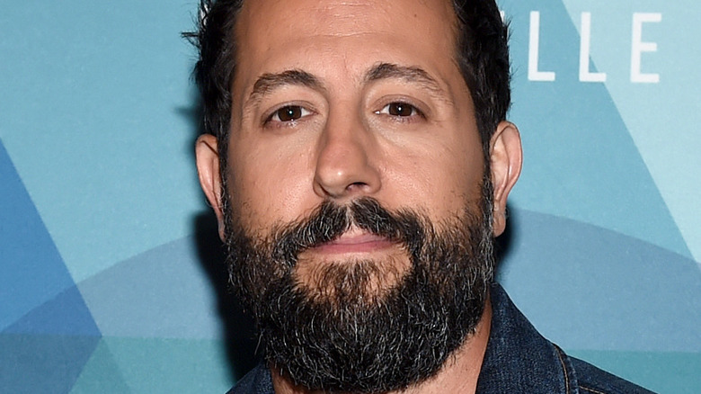 Matthew Ramsey smiles on the red carpet at an award show