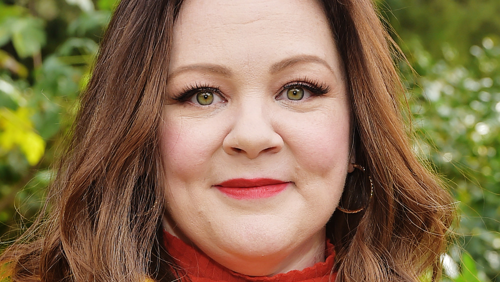 Melissa McCarthy smiles for a photo op at an event