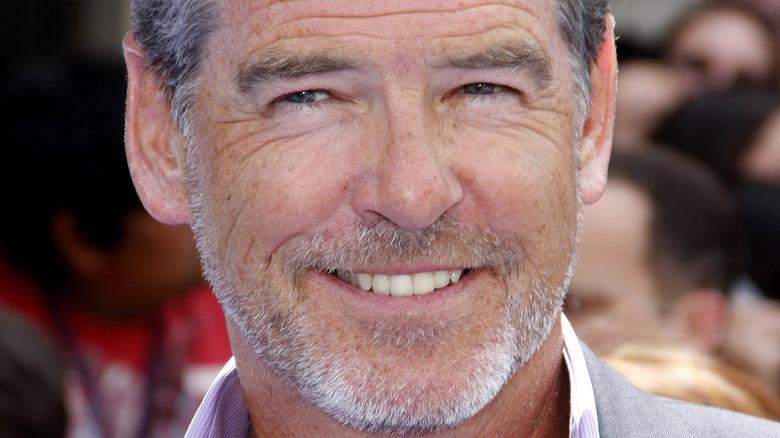 Pierce Brosnan smiling with beard