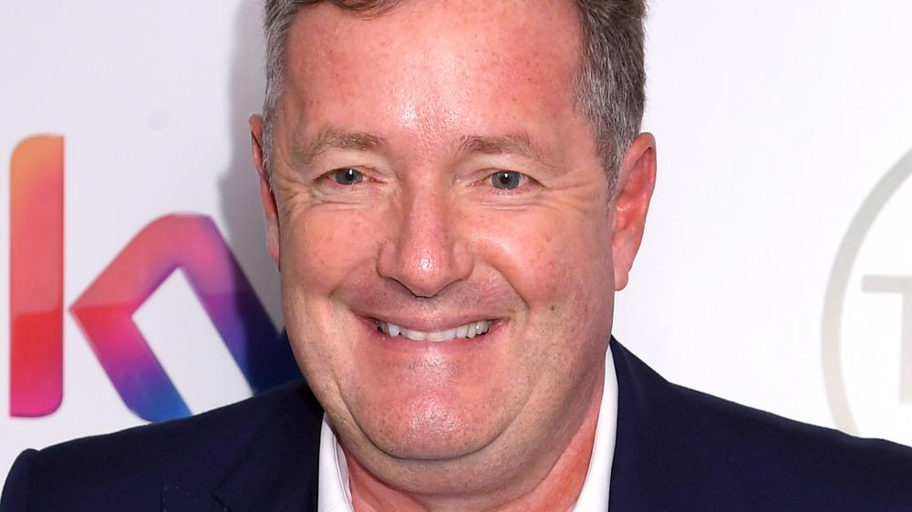 Piers Morgan posing on red carpet