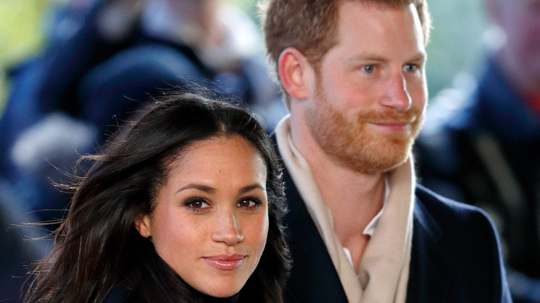 Meghan Markle and Prince Harry attending a Terrence Higgins Trust World AIDS Day charity fair