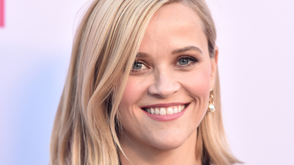 Reese Witherspoon smiles on the red carpet