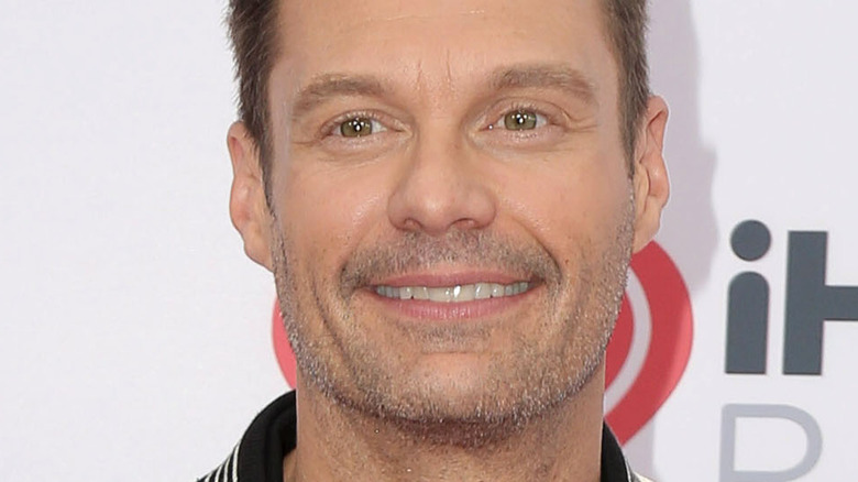 Ryan Seacrest smiling at an iHeart Radio event