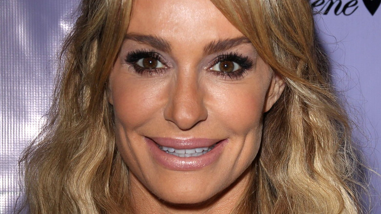 Taylor Armstrong smiling on red carpet