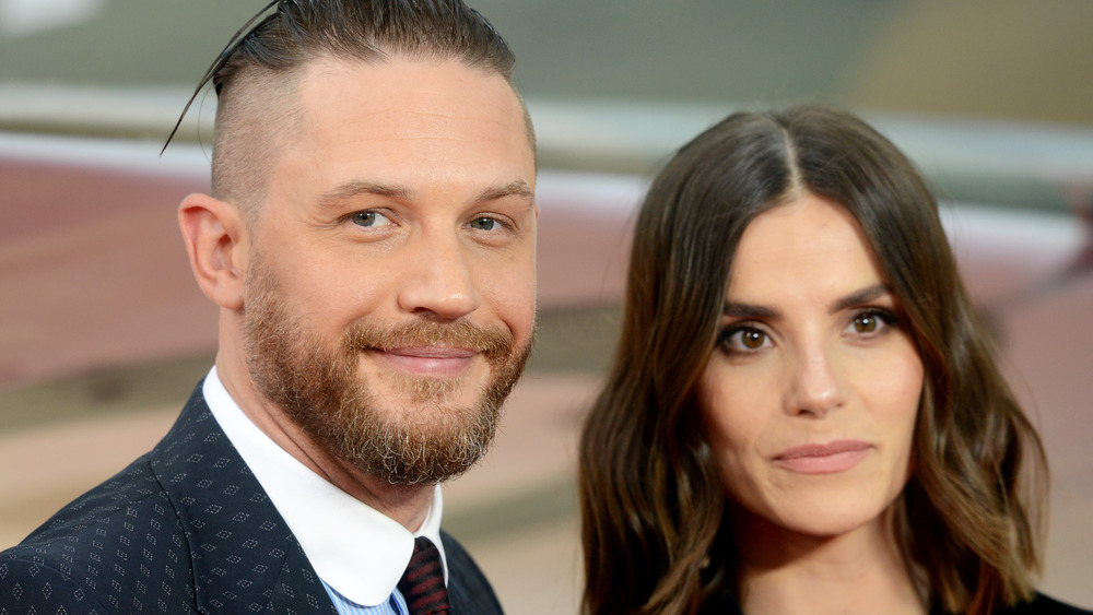 Charlotte Riley and Tom Hardy pose at an event