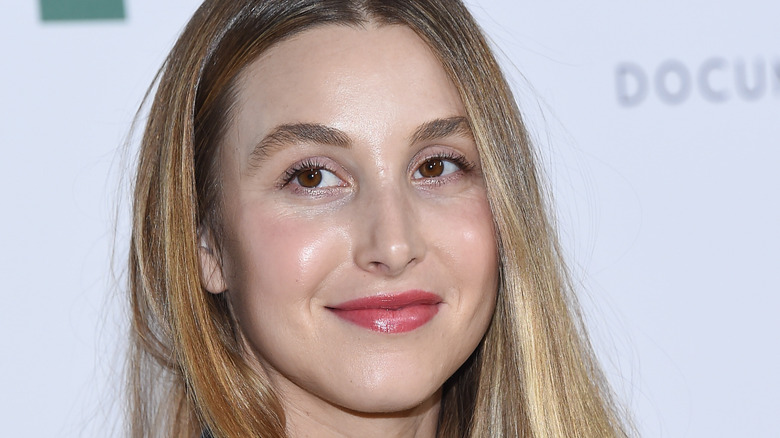 Whitney Port posing at a red carpet event