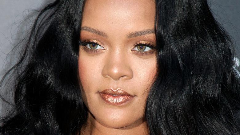 """Rihanna posing at a """"Fenty Beauty"""" event"""