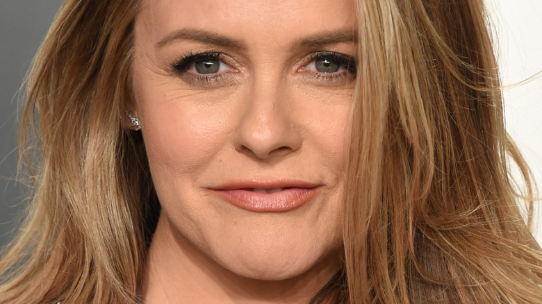 Alicia Silverstone smiling on the red carpet