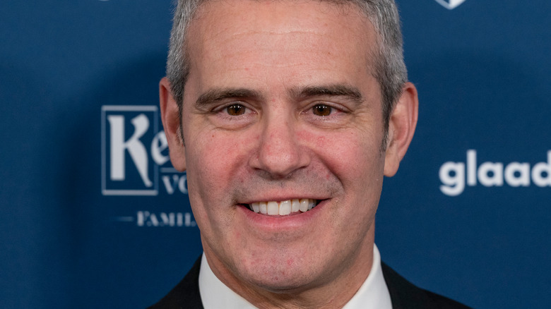Andy Cohen smiles on the red carpet