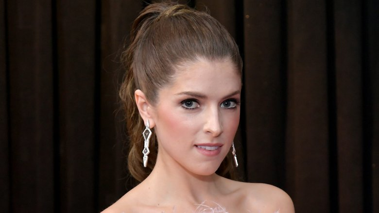 Anna Kendrick in a pink, feather-trim strapless dress