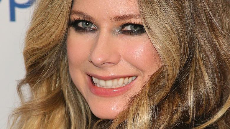 Avril Lavinge smiling on the red carpet