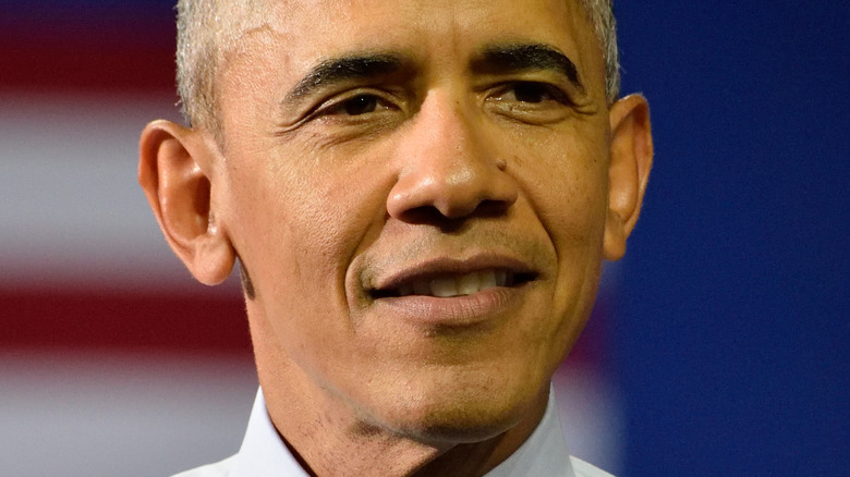 Barack Obama smiling and looking to the side