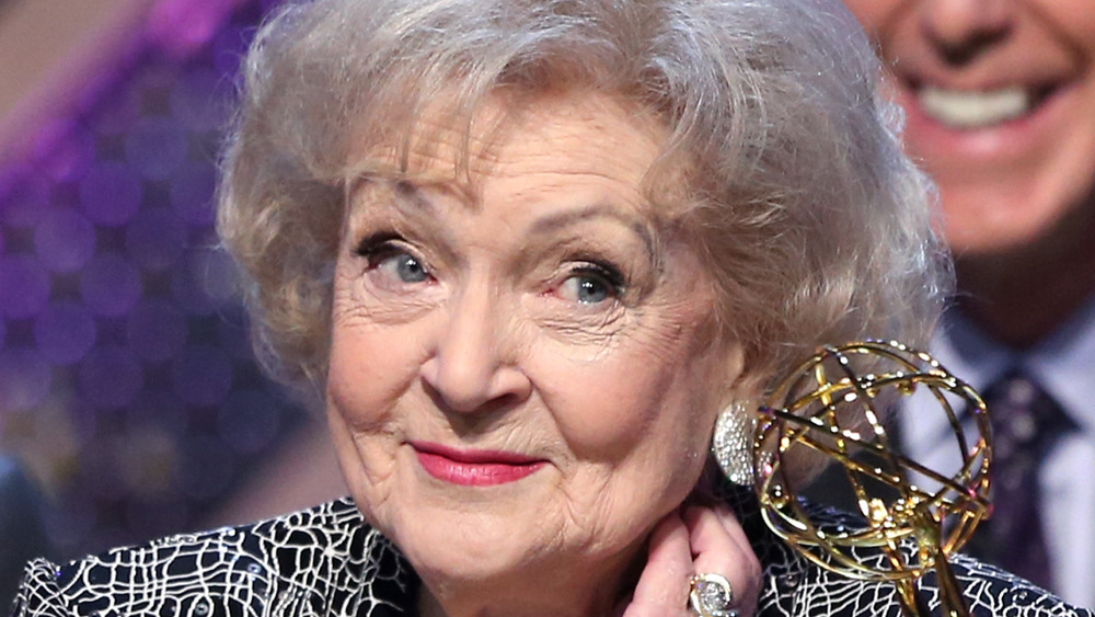 Betty White smiling at the podium at the Emmys