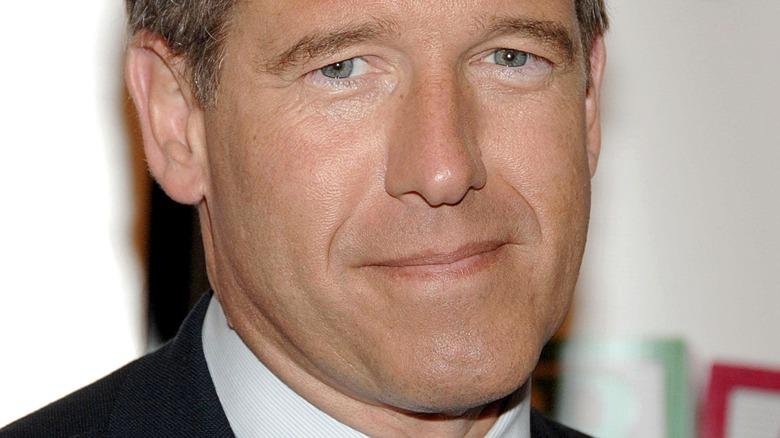 """Smiling Brian Williams at the """"Girls"""" season four series premiere in 2015"""