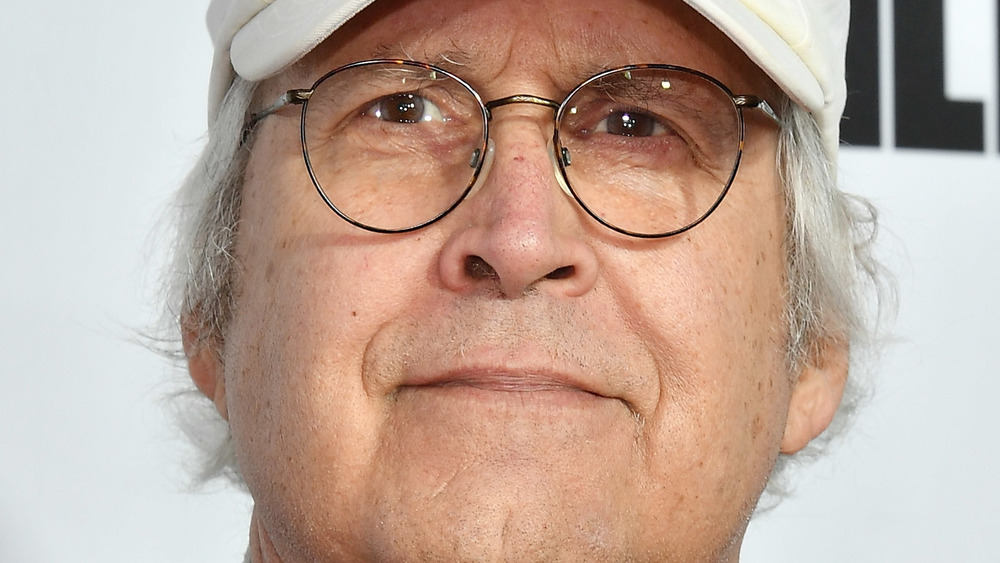 Chevy Chase smiling at a red carpet event