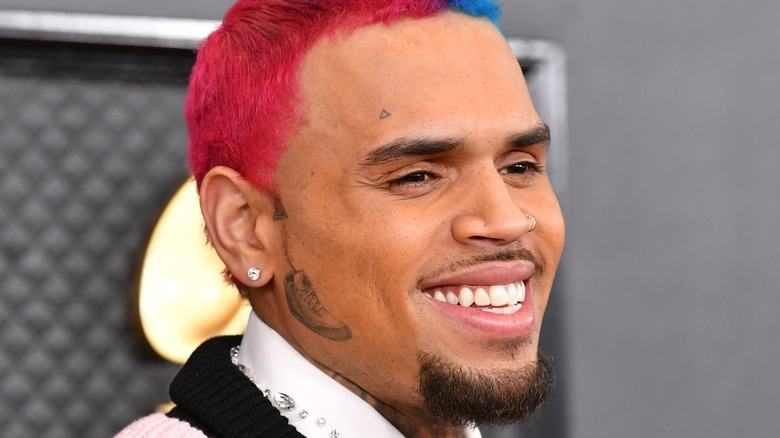Chris Brown smiling on the red carpet