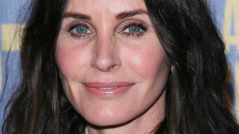Courteney Cox smiling on the red carpet