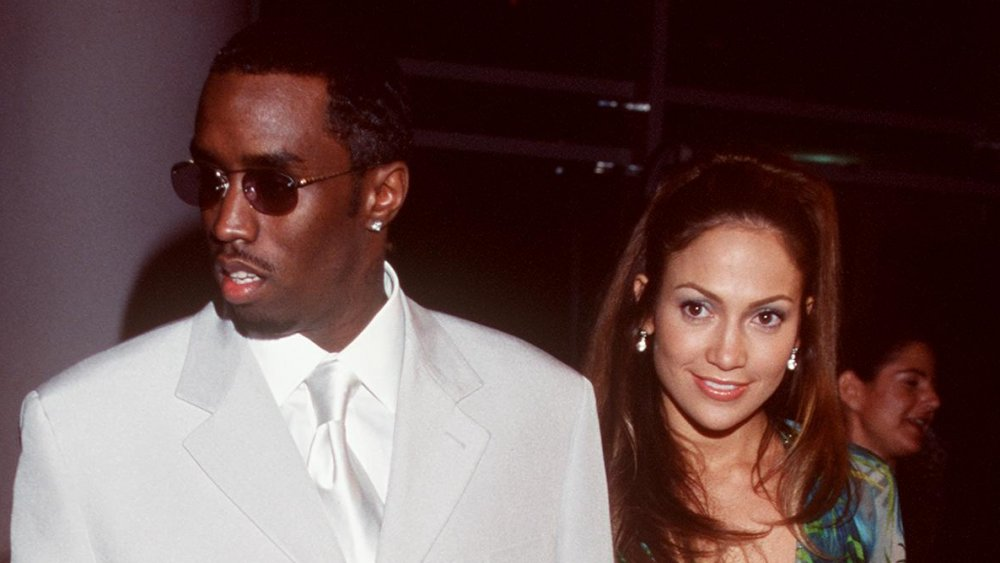 Sean Combs, Jennifer Lopez holding hands at the 2000 Grammys
