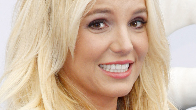 Britney Spears smiles for cameras