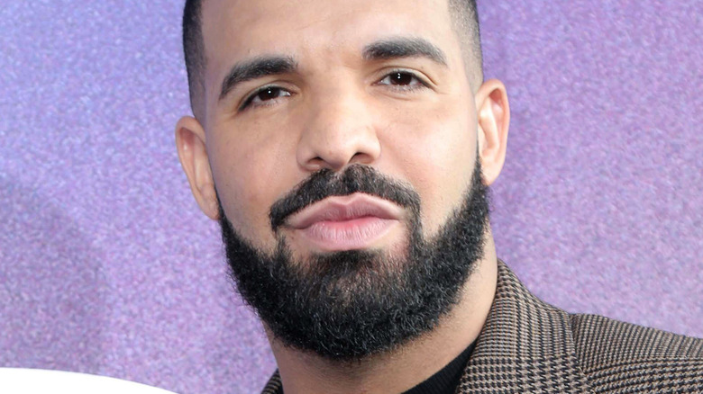 Drake on the red carpet with serious expression