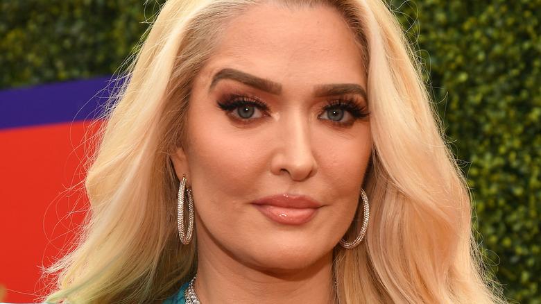 Erika Jayne, 2021 MTV awards, blond hair down, not smiling, wearing hoops