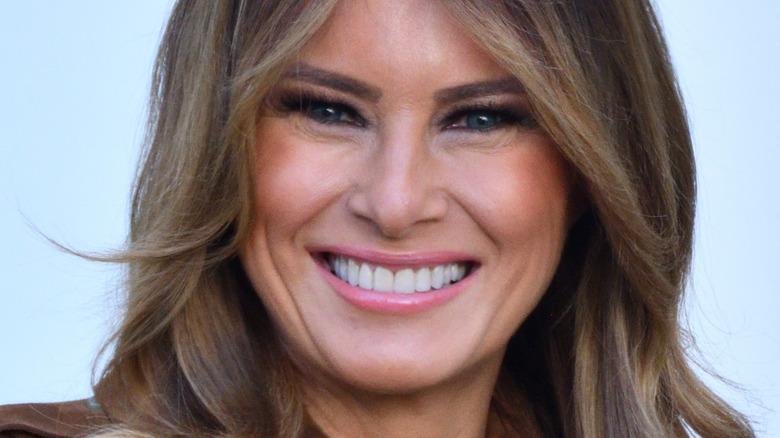 Melania Trump smiling and looking at camera