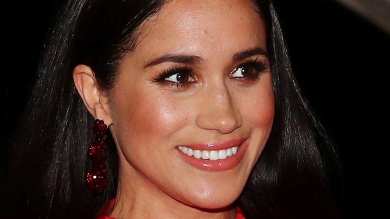 Meghan Markle wearing red earrings